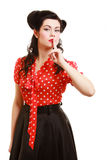 Retro. Pinup girl with finger on lips asking for silence Stock Image