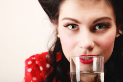 Retro. Pinup girl with glass of water drink Stock Images