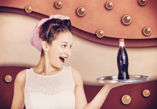 Retro pinup girl holding food and drinks tray Royalty Free Stock Image