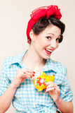 Retro pinup woman put money dollar note to porcelain mouse bank Stock Photos