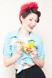 Retro pinup woman saving money Royalty Free Stock Photos