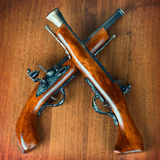 Retro pistols on a wooden background Stock Photos