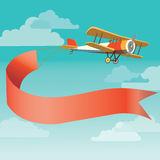 Retro plane with banner Stock Images
