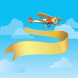 Retro plane with banner Stock Photography