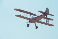 Retro plane. Flying in blue sky Stock Photo