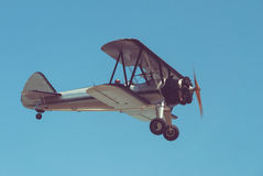 Retro plane. Flying in blue sky Stock Photography