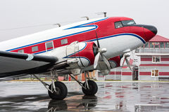Retro plane on the rainy day. At the airport stock image