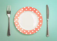 Retro plate with fork and knife top view Stock Photos