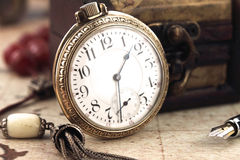 Retro Pocket watch. Antique Retro Pocket watch and decoration objects Royalty Free Stock Photo