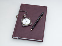 Retro pocket watch, diary and pen Stock Photography