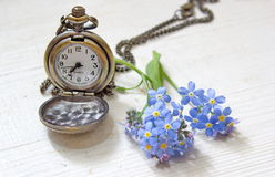 Retro pocket watch with forget me nots Royalty Free Stock Photos