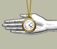 Retro pocket watch on the palm of woman`s hand Stock Photos