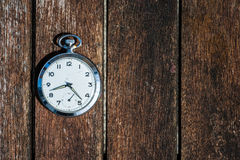 Retro pocket watch on wood Royalty Free Stock Photography