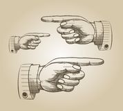 Retro pointing hand Stock Images