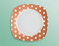Retro polka dot empty square plate top view Royalty Free Stock Image