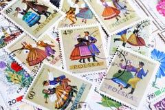 Retro- polnischer Beitrag der verschiedenen alten Weinlese stempelt mit nationaler Kleidung Lizenzfreies Stockbild