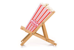 Retro popcorn on a deck chair Stock Image
