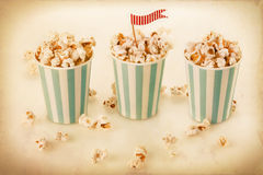 Retro popcorn in a striped cups Royalty Free Stock Image