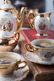 Retro porcelain coffee cups with hot espresso and dishware Royalty Free Stock Images