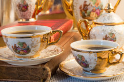 Retro porcelain coffee cups with hot espresso and vintage dishwa Royalty Free Stock Image