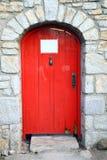 Retro porta rossa di legno Fotografie Stock
