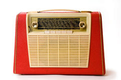 Retro portable radio. Old red radio with white background Stock Photos