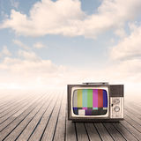 Retro portable television on pier. With sky on sunset Royalty Free Stock Photos