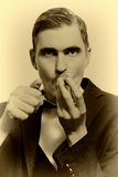 Retro portrait of adult man smoking pipe Royalty Free Stock Photography