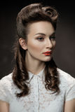 Retro portrait of a beautiful girl with hairstyle and red lips Royalty Free Stock Photo
