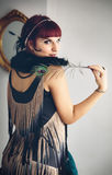 Retro portrait of beautiful woman with a feather in vintage styl Royalty Free Stock Photo