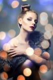 Retro portrait of beautiful woman in fur coat. Bokeh Stock Photography
