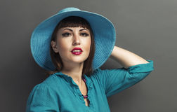 Retro portrait of a beautiful woman with hat. Vintage style. Fas Stock Photo