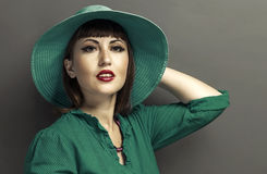 Retro portrait of a beautiful woman with hat. Stock Images