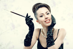 Retro portrait of beautiful woman smoking Royalty Free Stock Images