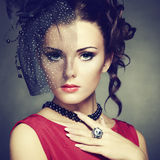 Retro portrait of a beautiful woman. Vintage style Royalty Free Stock Photos