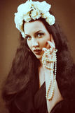 Retro portrait of a beautiful woman. Vintage style. Stock Photography