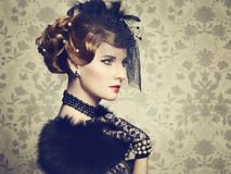 Retro portrait of  beautiful woman. Vintage style Stock Image