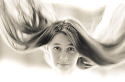Retro portrait of beautiful young girl with flying hair. Stock Images