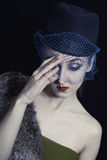 Retro portrait of a beautiful young woman in  hat with  veil Royalty Free Stock Images