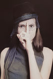 Retro portrait of a beautiful young woman in a hat with a veil Royalty Free Stock Image