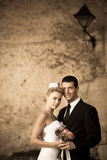 Retro portrait of bride and groom on a street Royalty Free Stock Image