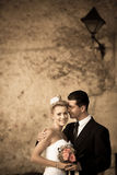 Retro portrait of bride and groom on a street Royalty Free Stock Photo