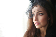 Retro portrait of Elegant brunette woman wearing in hat with vei Royalty Free Stock Photos