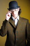 Retro portrait of english gentleman in bowler hat. Close up retro portrait of young english gentleman in bowler hat and retro glasses stock photo
