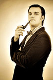 Retro portrait of a gentleman smoking pipe Stock Photography
