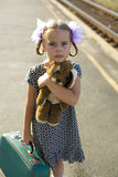 Retro portrait of a little girl at railway platform Royalty Free Stock Photo