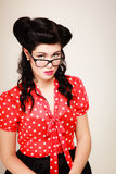 Retro. Portrait of pinup girl in eyeglasses Royalty Free Stock Photography