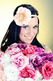 Retro portrait of Pretty woman with roses Royalty Free Stock Photography