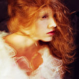 Retro portrait of red-haired queen like girl. Studio shot royalty free stock photo