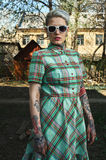 Retro Portrait of tattooed blonde Model with Dress and Sunglasse Royalty Free Stock Photography